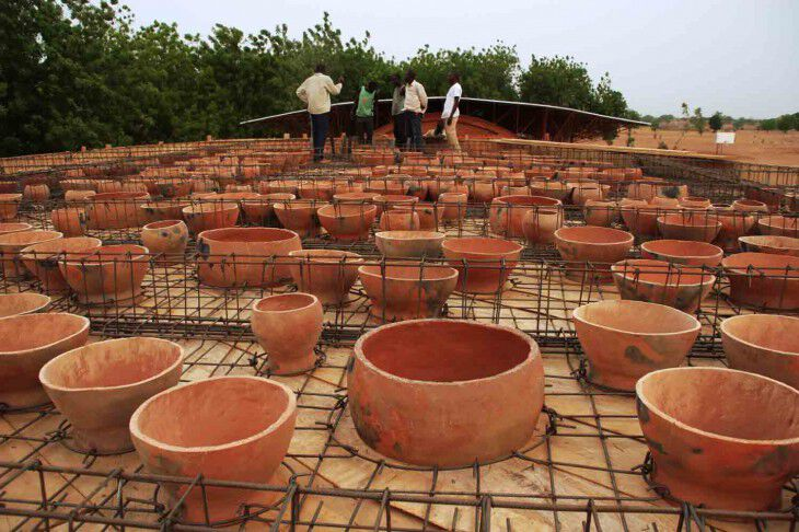 5 installing the pots on the roof of the library